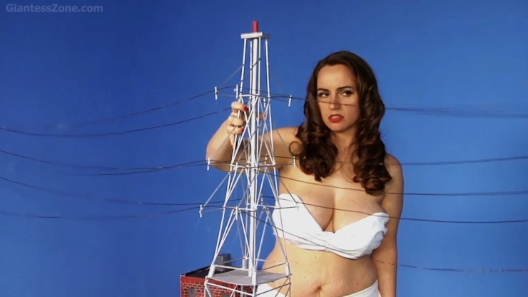 Nancy grabs power line tower -- nice prop